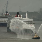 Cunard liners Queen Mary 2, Queen Victoria and Queen Elizabeth arrive on the River Mersey in Liverpool